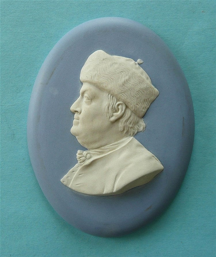 Benjamin Franklin: a Wedgwood blue jasperware oval medallion applied in whi