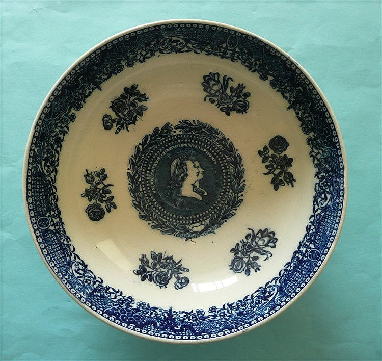George III: a good pearlware bowl of large size printed in blue, the exteri