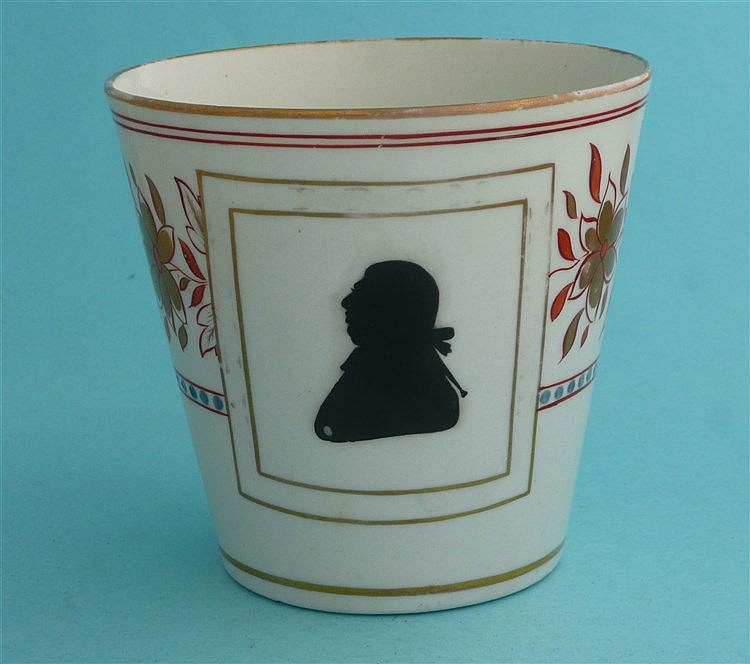 George III: a colourful English porcelain beaker decorated in black with a