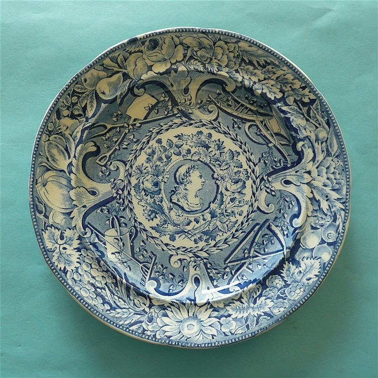 George III: a pearlware plate by Davenport printed all over in blue with ce