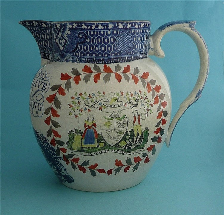 George III: a pearlware beer jug printed in blue with a crown, loyal inscri
