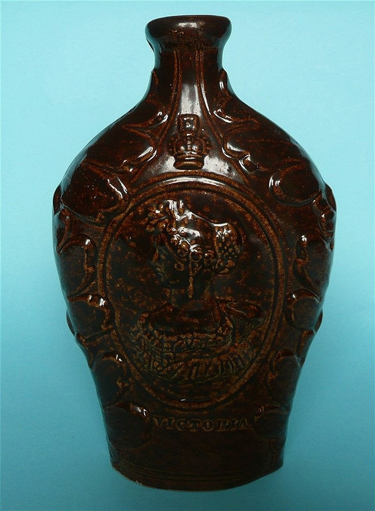 1837 Victoria: a brown glazed stoneware spirit flask moulded with named por