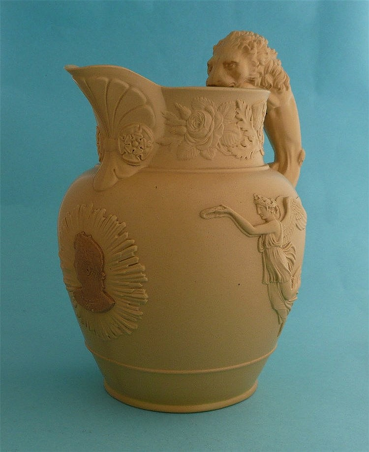 George IV: a buff coloured stoneware jug set with a lion handle and applied