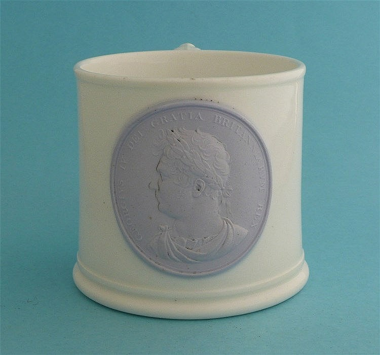 1821 Coronation: a white porcelain mug applied with a lilac coloured medall
