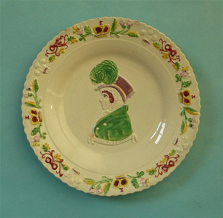 Queen Caroline: a Scottish pottery plate the colourful moulded border centr