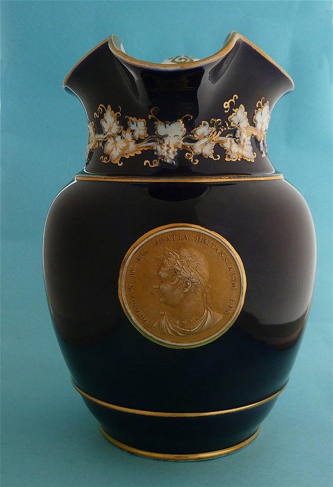 George IV: a large cobalt blue ground porcelain jug moulded with a gilded p