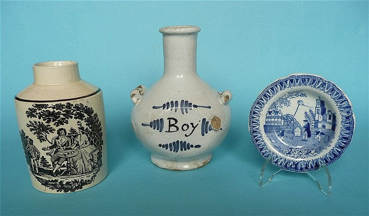 An 18th century Delft pottery bottle the shoulders set with twin handles, p