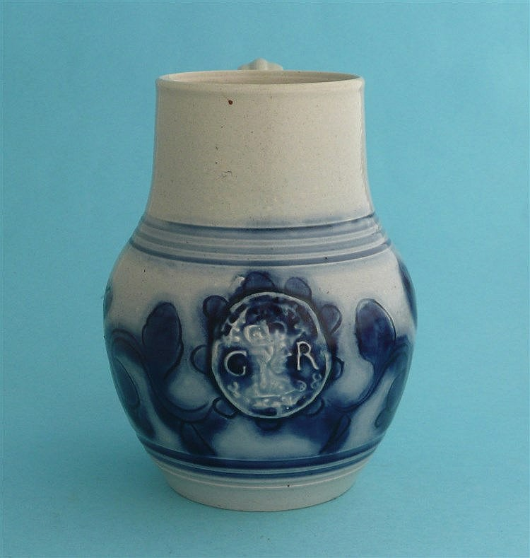 George III: a squat pearlware baluster shaped ewer moulded with a medallion
