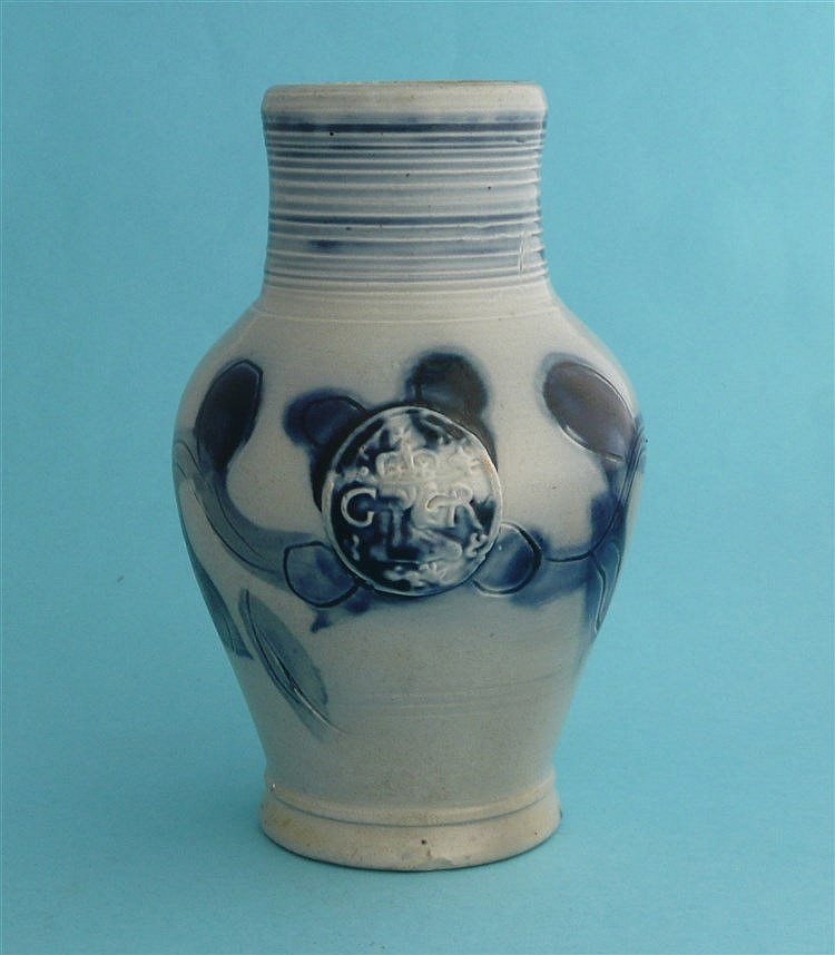 George III: a pottery baluster shaped ewer moulded with a crowned head in p