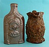 A brown stoneware flask moulded with named portraits of Victoria and the Du