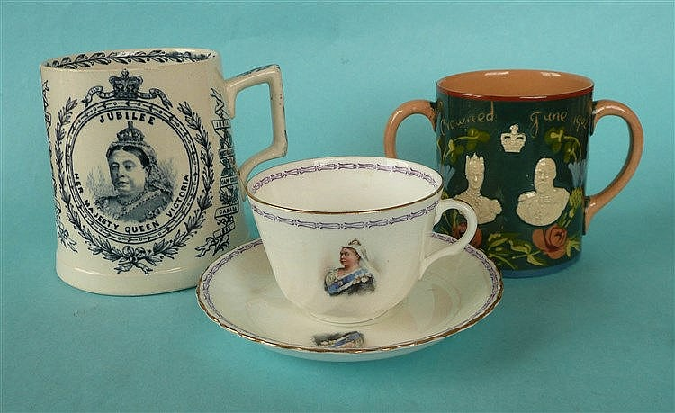 A tapering pottery mug for 1887 jubilee, a Doulton Burslem cup and saucer f
