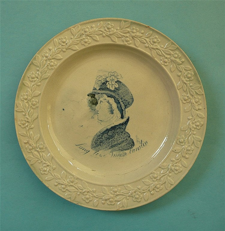 Queen Caroline: a pottery nursery plate with floral and foliate moulded bor