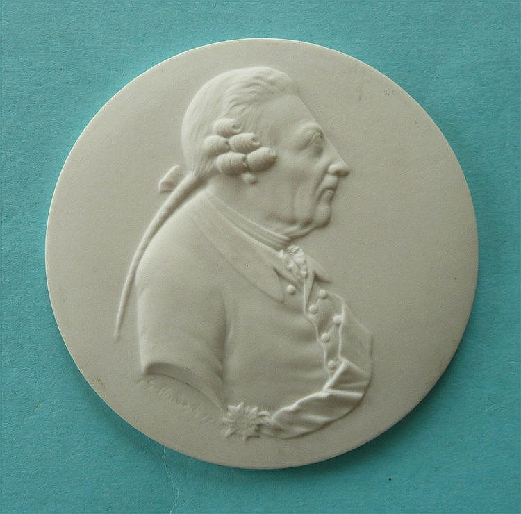 Frederick the Great: a Berlin porcelain circular white bisque medallion mou