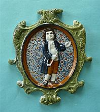 A Prattware plaque 'The Parson' moulded with integral elaborate scroll fram