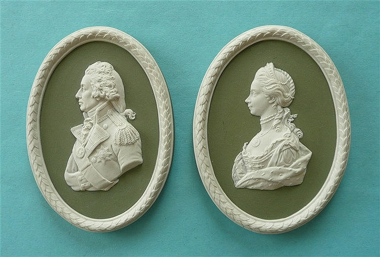 A pair of 20th century Wedgwood green jasperware portrait medallions depict