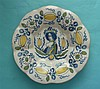 Queen Mary: a Dutch Delft polychrome dish painted with a half-length portra