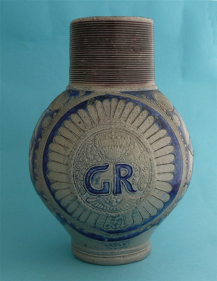 A Westerwald grey stoneware ewer moulded with GR monogram surmounted by a c