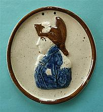 A rare oval Prattware portrait medallion moulded with a half-length profile