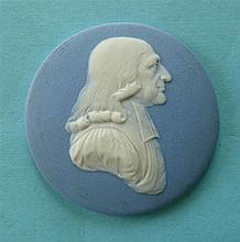 John Wesley: a Wedgwood blue jasperware circular medallion applied in white