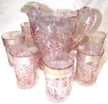 """Lot 115: Floral Pattern Pink Glass Pitcher with eight 4 1/2"""" Thumblers, EC"""