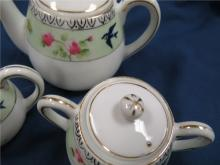 "Lot 15: Three Piece Child's Tea Set, 3 1/4"" Pitcher, 2 1/2"" C/S, EC except for small flake as shown"