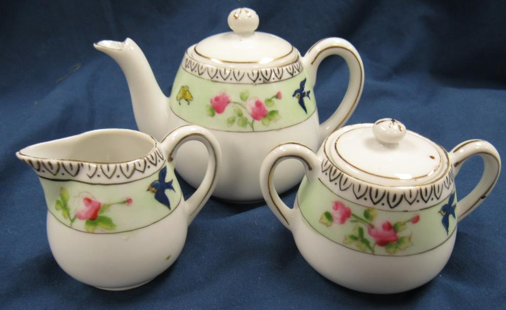 """Three Piece Child's Tea Set, 3 1/4"""" Pitcher, 2 1/2"""" C/S, EC except for small flake as shown"""