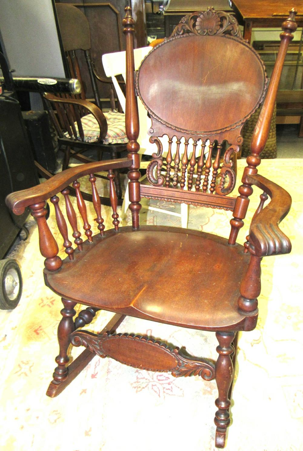 Lot 92: 1800's Fancy Victorian Antique Carved Rocking Chair, All Responsibility for Shipping will be the Successful Bidder. You must arrange for pickup directly or by a shipper within 7 days after sale.