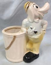Lodge Ceramic 1926-1927 dog standing at  trash can, 5 1/2