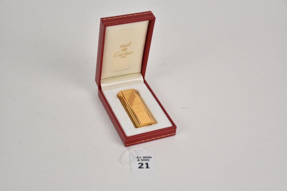 Must De Cartier Gold Plated Lighter - c. 1980s Must de Cartier gold plated lighter.