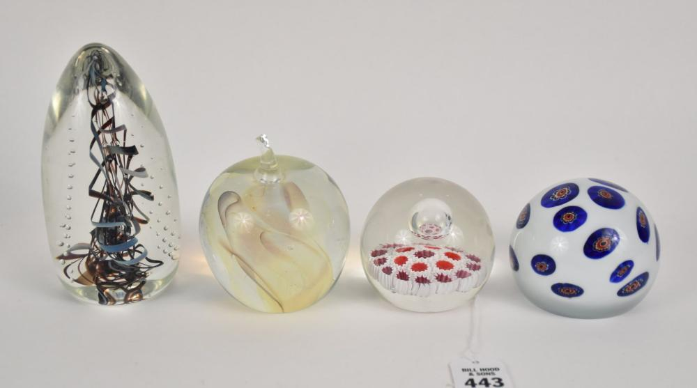 """Four Art Glass Paperweights - Signed Gilbert C. Johnson APPLE 1989 4"""" H; Signed """"Egg"""" 1992 (Signature looks like HL Marut) 6""""H; two unsigned Millefiori paperweights. Condition: Minor normal wear, one millefiori has two small chips on bottom edge."""