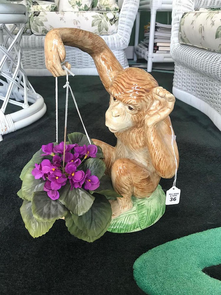 """Hand-Painted Italian Pottery Monkey - Holding a potted silk flower. Condition: Good. Dimensions: 16"""" H."""
