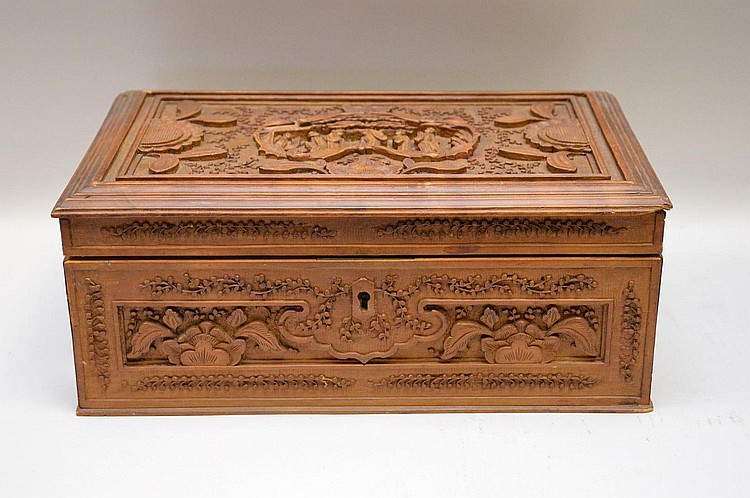 Carved Wood Chinese Jewelry Box. The top with carved figures in a landscape scene. Each side with floral and scroll design. Ht. 5 1/4