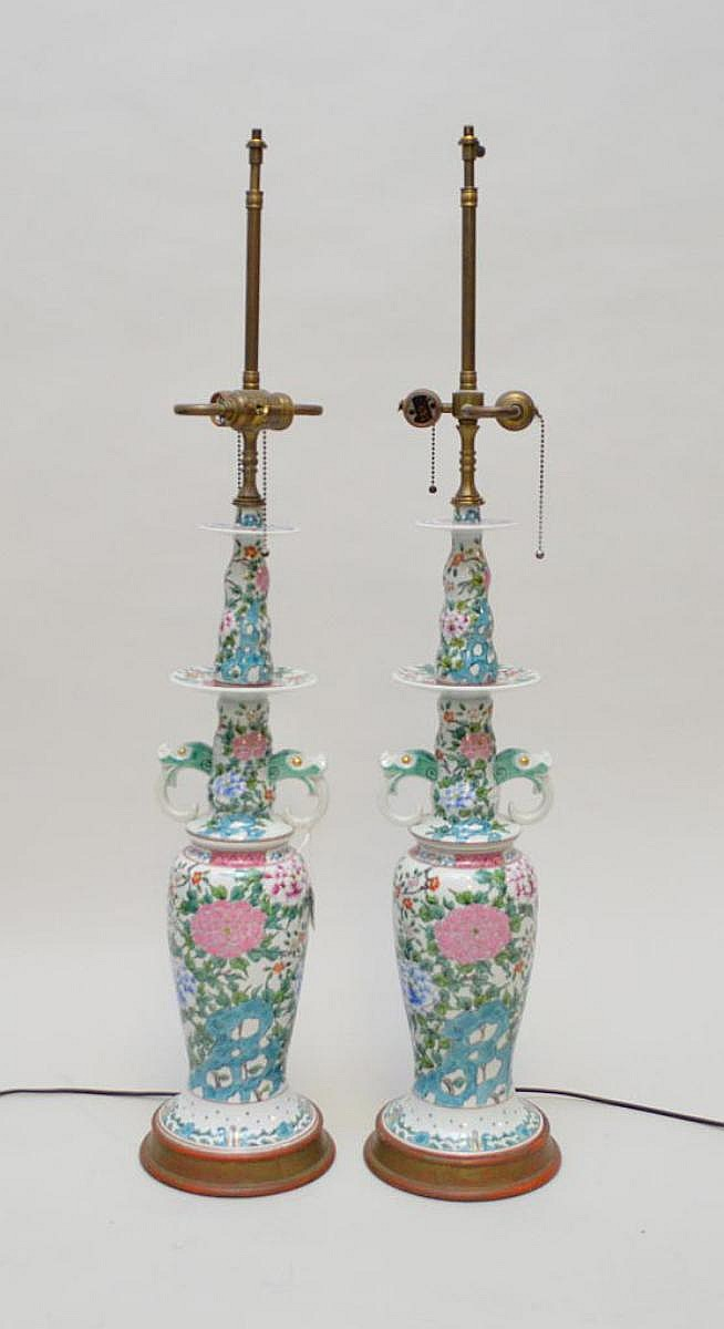 Pair Chinese Porcelain Candlesticks now electrified and mounted as lamps. Condition: good and working with slight wear to the gilt wood bases. Ht. To the socket 27