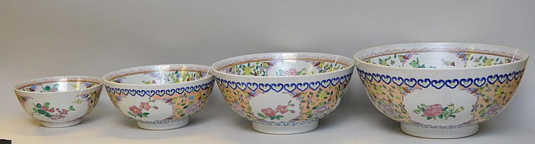 4 Chinese Porcelain Graduated Bowls with bird, butterfly and foliate decoration. Condition: good with no cracks or chips. Largest Bowl Ht. 6 1/2