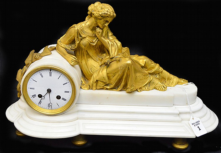 19th Century French White Marble & Gilt Bronze Clock - Features a Neoclassical leaning Goddess in robes, five supports. Time and strikes movement by Milroy Fre bte-s c. Paris. Registry mark #1175. Condition: Two very small chips to marble on