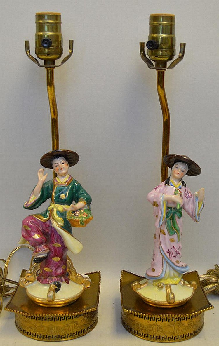 """Pair of French Porcelain Chinoiserie Figure Lamps, brass base with beach landscapes in relief. Condition: Female figure is missing a hand. Dimensions: figure 8"""" H, overall 24"""" H."""