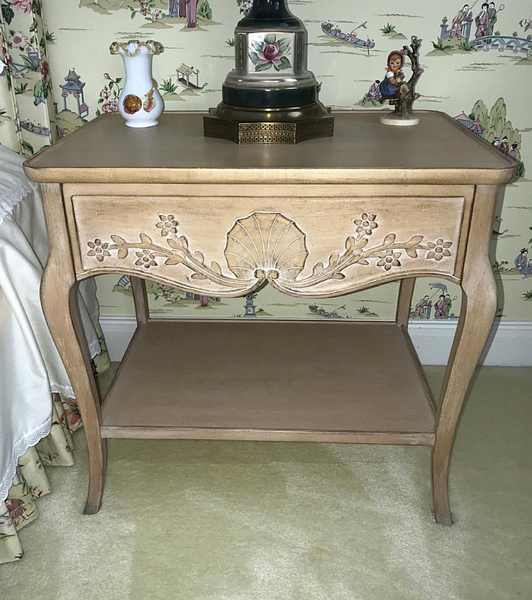 """Pair of Lewis Mittan Carved Light Wood Night Tables, with shell and floral carved decoration, one drawer above a shelf. Condition: Good, with minor normal wear. Dimensions: 25 1/2"""" H x 27"""" W x 19"""" D."""