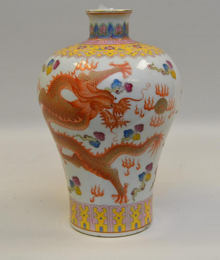 Chinese Porcelain Meiping Vase Featuring Dragon - Enamel and paint on a white porcelain ground. Blue under glaze six character mark on bottom. Condition: Good, with no cracks or chips, some loss to gilt paint on rim. Dimensions: 8