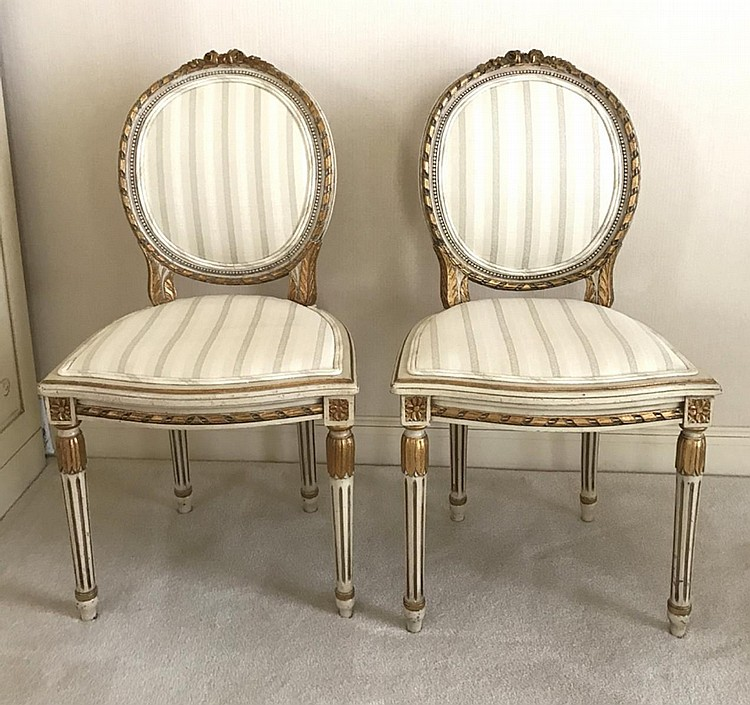 """Pair of French Carved Painted & Gilded Side Chairs Condition: Good, with minor normal wear. Dimensions: 36"""" H x 19 1/2"""" W x 17"""" D, seat height - 17 1/2""""."""