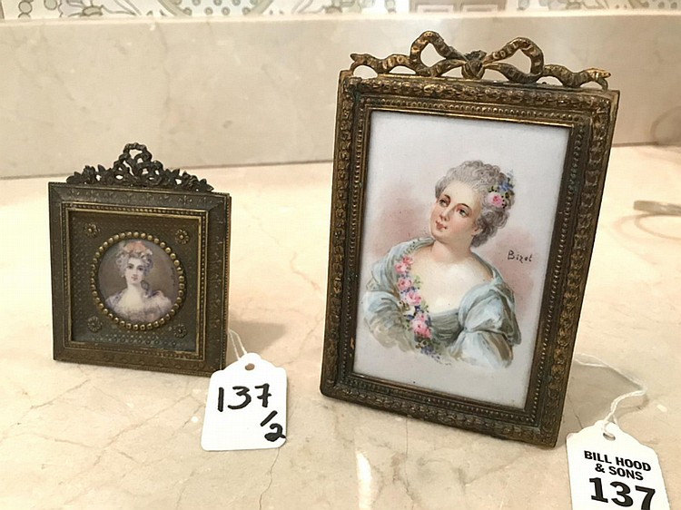 "Two 19th Century Portraits of Ladies in 18th Century Costume, portraits are painted on porcelain. Gilt metal frame. Dimensions: Larger 5"" H x 3 1/4"" W; Marie Antoinette 3 1/2"" H x 3"" W."