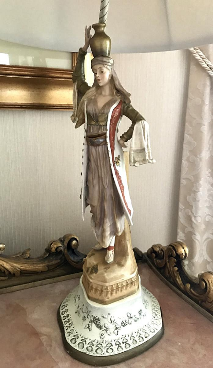 "Porcelain Figure of Maiden with Water Jug Lamp Condition: Good with no noticeable damage. Dimensions: figure height 13 3/4"" H, overall to finial - 31"" H."