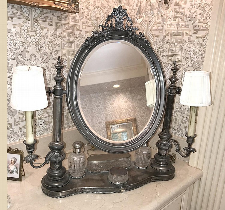 19th Century French Silverplate Ladies Dressing Vanity, with four pieces of glass and silver-plate dressing articles (2 scent bottles, one powder, and one container for hair articles), two candlesticks sit on either side of the mirror, now