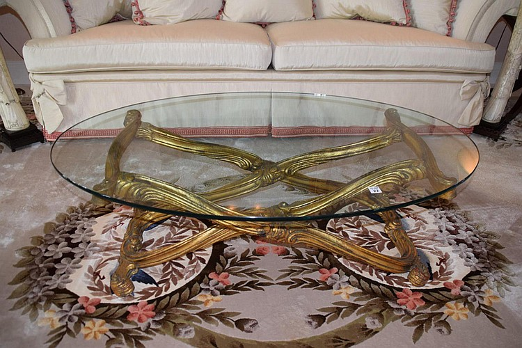 "Carved Gilt Wood & Glass Top Coffee Table - Carved gilt wood with scroll design. Condition: Good Dimensions: 14"" H x 46"" W x 28 1/2"" D."