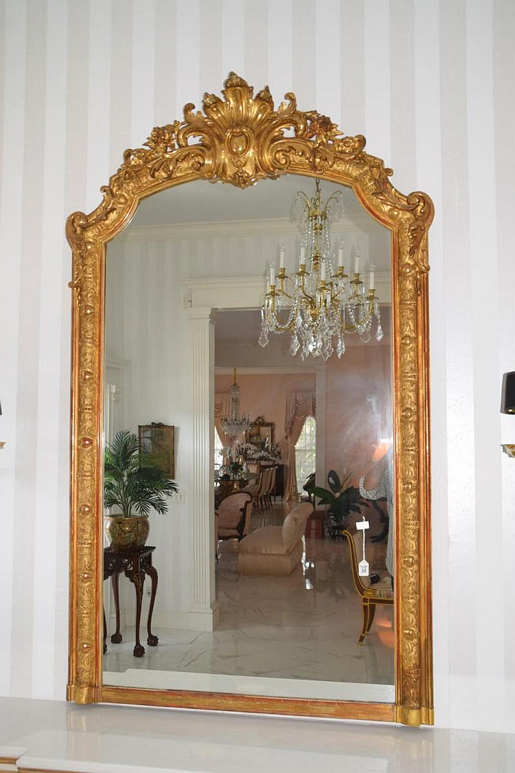 "19th Century Italian Carved Gilt Wood Pier Mirror - Gorgeous ornate detailing. Condition: Good with only minor normal wear. Gilding is tastefully rubbed to red. Dimensions: 78"" H x 44"" W"