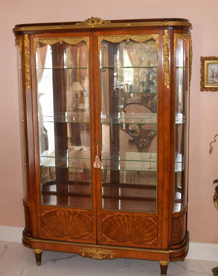 """19th Century French Inlaid Wood Cabinet with Gilt Bronze Accents. Three Glass shelves, mirrored back, matching key, with electrified lid interior. Condition: Good for its age with some rubbing to mirror in a few places. Dimensions: 72 1/2"""" H x"""