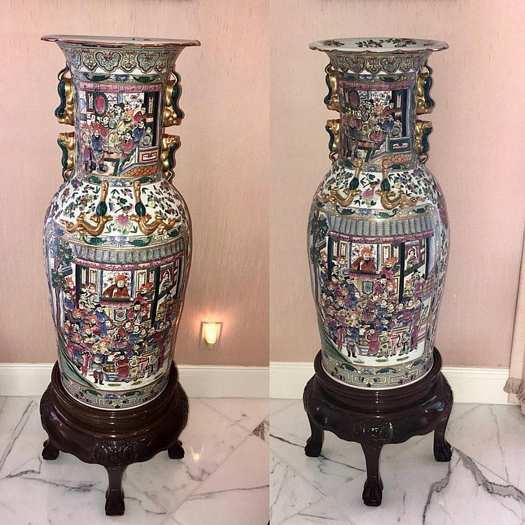 """Pair of Large Chinese Rose Medallion-Style Vases - raised on custom carved wood bases. Features scenes of multiple people. Condition: Good, with no noticeable damage. Dimensions: Without base - 36"""" H x 13 3/4"""" diameter. Overall height, including"""