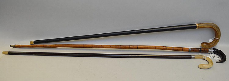 Three Antique Horn-Topped Walking Sticks - One bamboo & black horn cane with sterling silver connectors 38 1/4