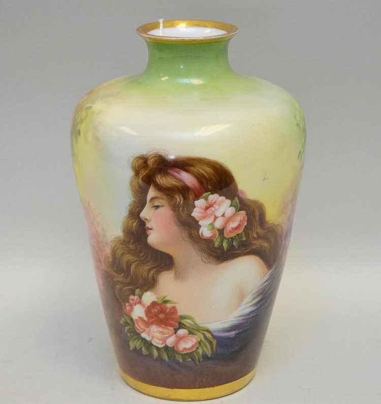 Dresden Handpainted Porcelain Portrait Vase depicting a maiden holding a bouquet with flowers in her hair. Condition: good with no cracks chips or scratches. Artist signed Rommler. Vase Ht. 7.5