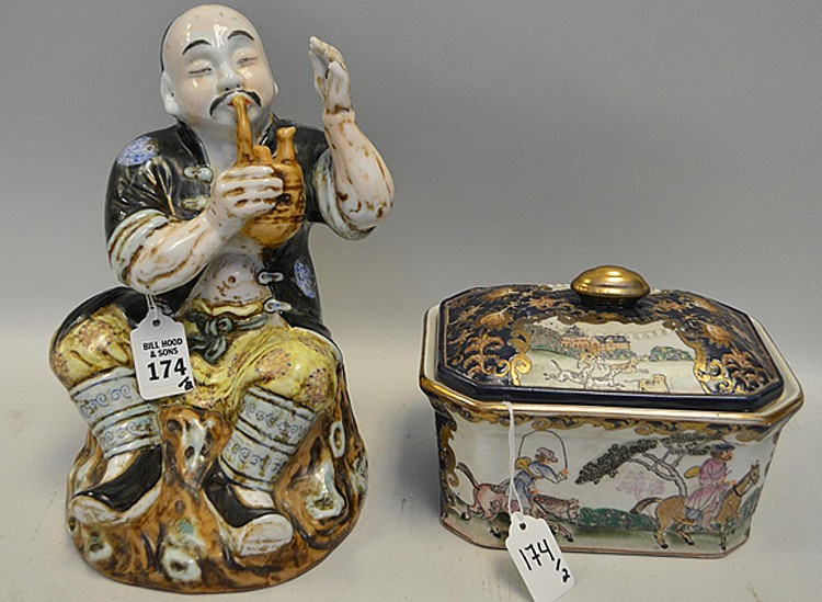 """Two Pieces of Chinese Porcelain - One figure of a man smoking a pipe, in good condition, 10"""" H. One porcelain tureen & cover, in good condition, 5"""" H x 7 1/4"""" W x 5 1/2"""" D."""