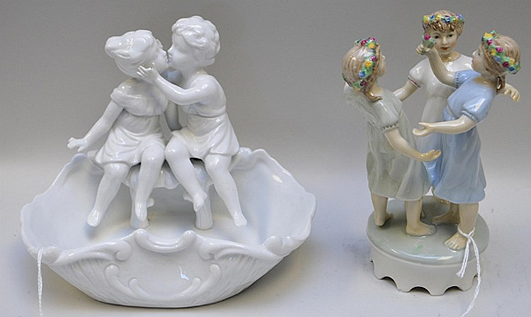 """Two German Porcelain Figural Groups One group depicting """"Three Graces"""" with flowers, 6 1/4"""" H, in good condition. One figural porcelain bowl, 5 1/2"""" H x 7 1/2"""" W x 4 1/2"""" D, in good condition."""
